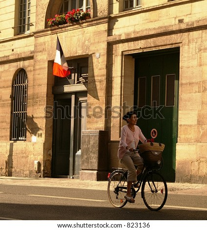 Woman Cyclist in Paris - stock photo