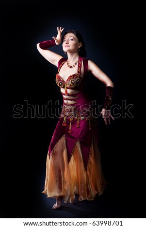 Woman dance in dark - traditional arabic dress