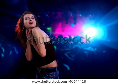 Woman dancing at a disco - stock photo