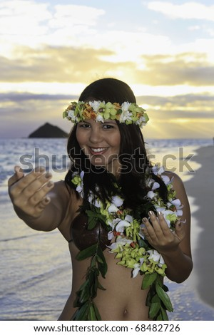 woman dancing hula by the ocean in hawaii - stock photo