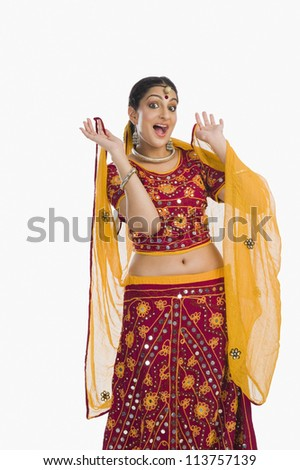 Woman dancing in red lehenga choli - stock photo