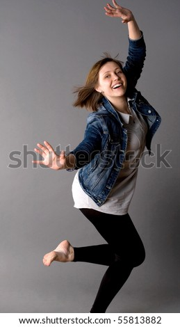 Woman dancing in studio - stock photo