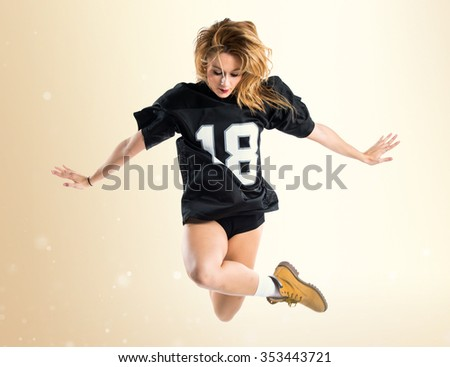 Woman dancing street dance and jumping - stock photo
