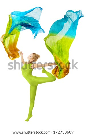 Woman dancing with fluttering flying colorful fabric. dancer with flexible body over white background, beauty in sport and fitness.