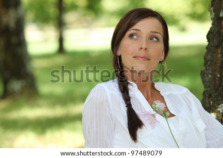 Woman daydreaming about her lover - stock photo