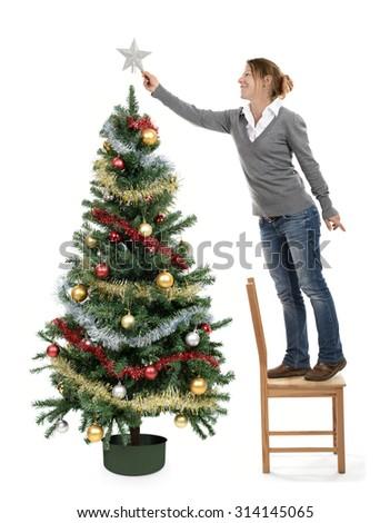 Woman decorating a christmas tree  - stock photo