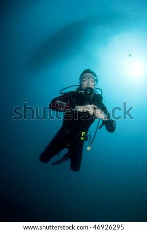 woman deep underwater scuba diving - stock photo