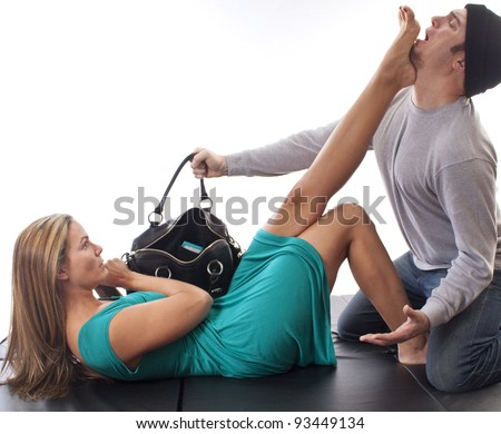 Woman defending herself from a purse thief   - stock photo
