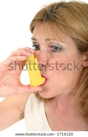 Woman demonstrates the use of an asthma or bronchial inhaler. - stock photo