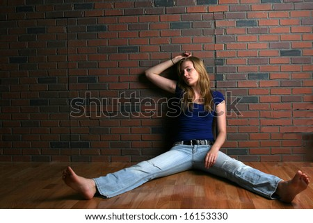 woman depicting the concept of depression and hopelessness - stock photo