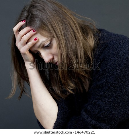 Woman desperate on black background - stock photo