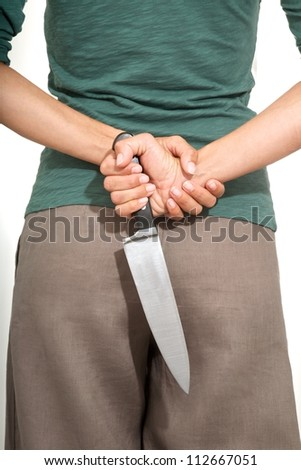 woman detail back with a big knife on her hands - stock photo