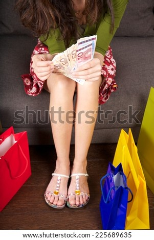 woman detail with group of Euro bills in her hands - stock photo