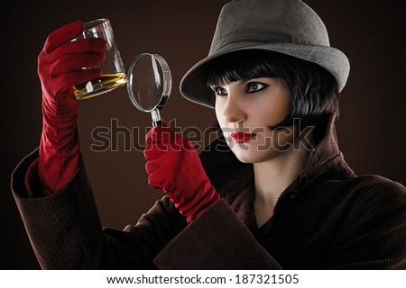 woman detective examines the evidence - stock photo