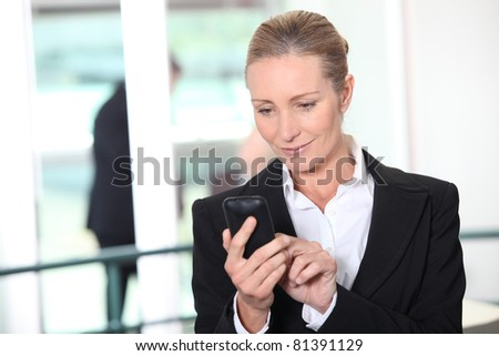 Woman dialing phone number - stock photo