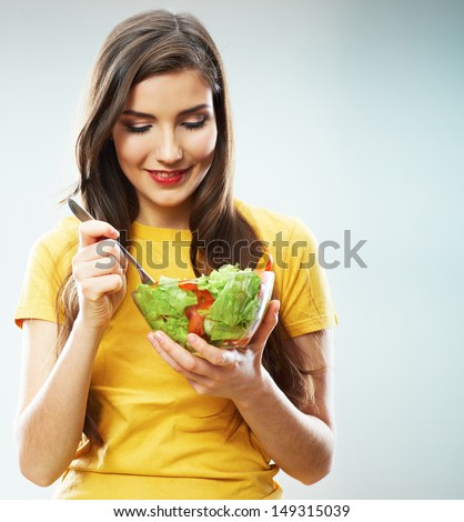 Woman diet concept portrait. Female model hold green salad. Isolated portrait.