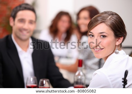 Woman dining with her partner in a restaurant - stock photo