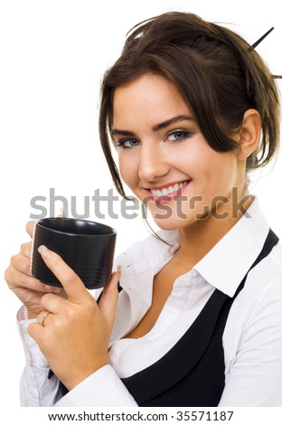 Woman dirinking tea, smiling and looking at camera wearing formal clothes - stock photo