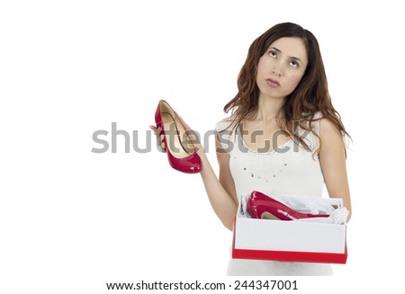 Woman disappointed about her gift - stock photo