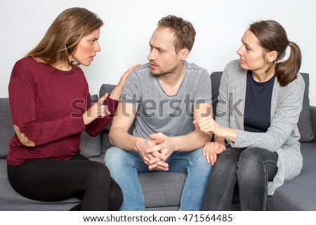 Woman discussing with man with friend listening