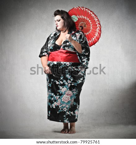 woman disguised as a geisha - stock photo