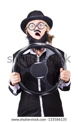 Woman disguised as man with beard holding steering wheel, defensive driver concept on white background.