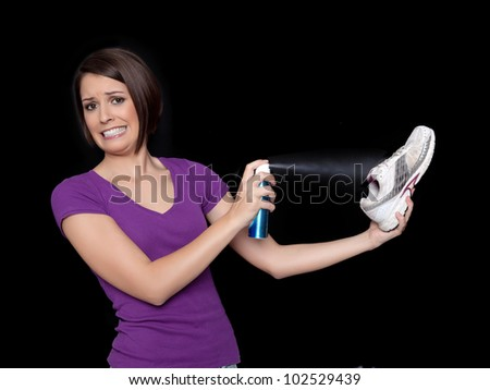 Woman disinfects her shoes - stock photo