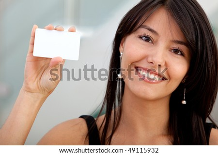 Woman displaying a personal business card at the office - stock photo