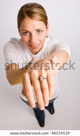 Woman displaying engagement ring - stock photo