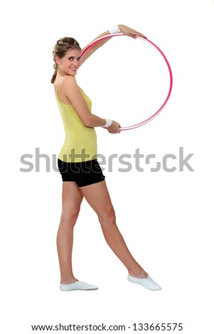Woman displaying hula-hoop - stock photo