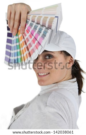 Woman displaying paint swatch - stock photo
