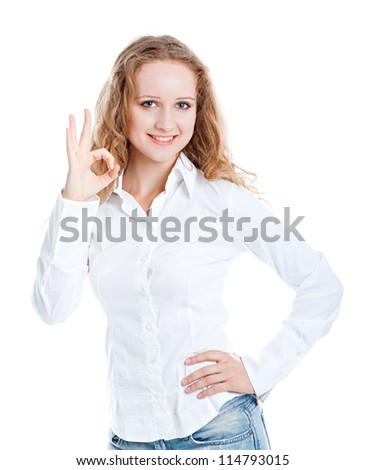 woman displays OK isolated on white background.