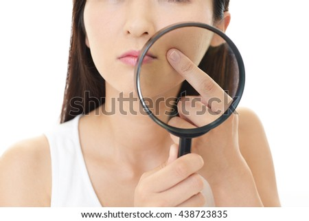 Woman dissatisfied with the skin care - stock photo