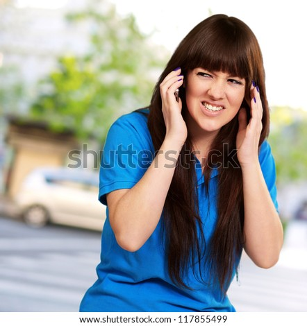 Woman Disturbed By Noise, Outdoor - stock photo