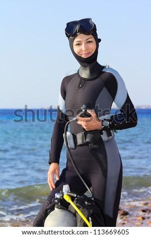 Woman diver prepares to dive - stock photo