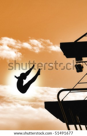 woman diving from the platform - stock photo