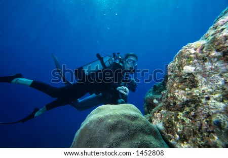 Woman diving on a coral reef