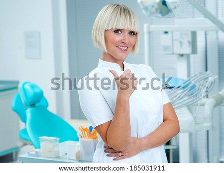 woman doctor dentist, gynecologist or oncologist smiling in her office - stock photo
