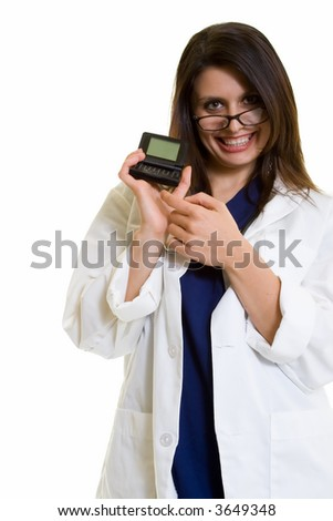 Woman doctor in glasses wearing a doctors lab coat holding up and pointing to an open pager showing blank screen standing on white
