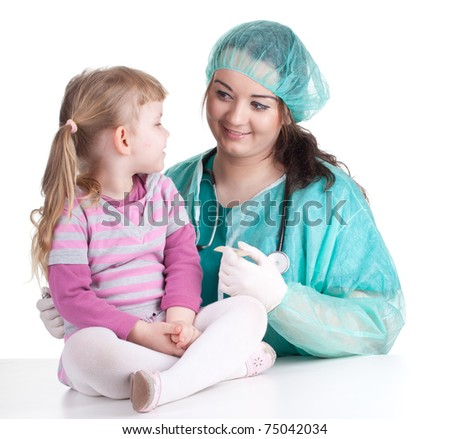 woman doctor in green workwear exam small young girl - stock photo
