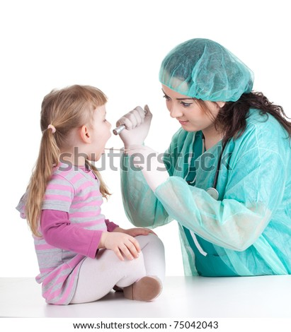 woman doctor in green workwear exam small young girl