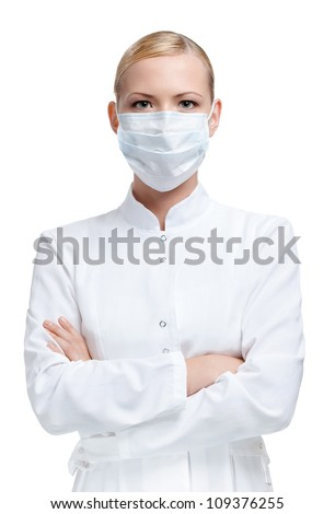 Woman doctor is in medical gown and respirator, isolated on white - stock photo