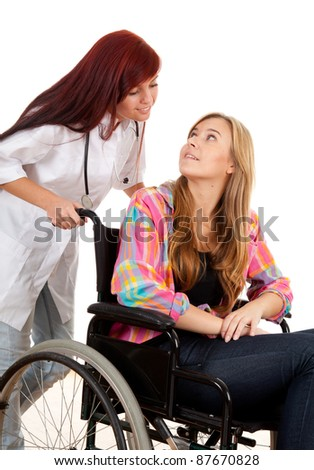 woman doctor or nurse is pushing her patient on a wheelchair