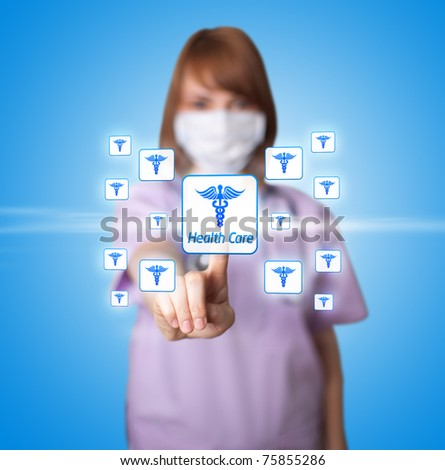 woman doctor pressing digital button ( Medical theme ) - stock photo