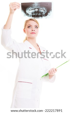 Woman doctor radiologist in lab coat with clipboard looking at the x-ray isolated. Medical person for health insurance. - stock photo