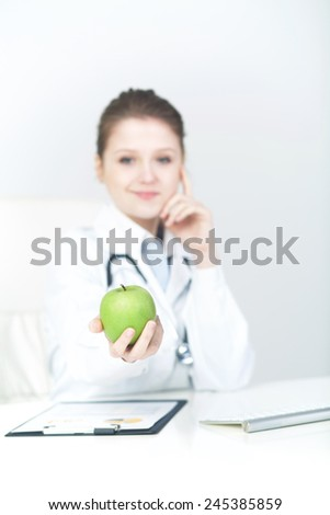 Woman Doctor Recommending An Apple  - stock photo