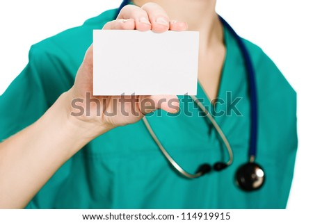 Woman doctor showing business card on a white background.
