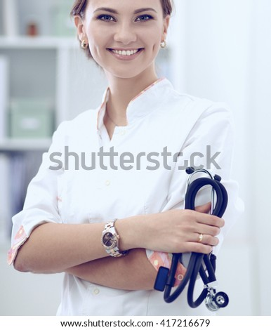Woman doctor standingat hospital - stock photo