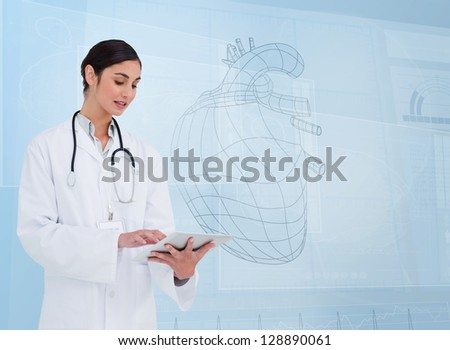 Woman doctor using a tablet pc in front of hearth sketch display screen - stock photo