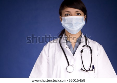 Woman Doctor Wearing A Mask Examining You - stock photo